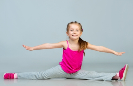 beautiful girl sits on a splits