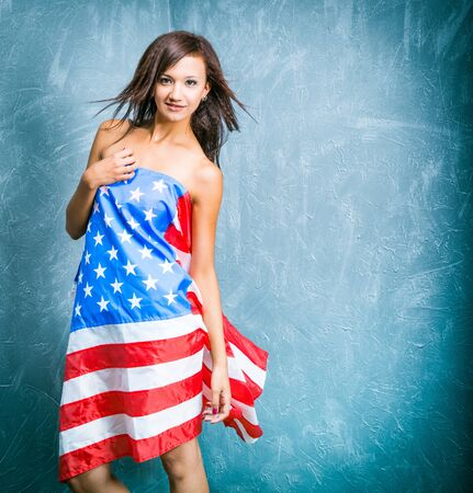 fashion girls with usa flag against textured wall photo