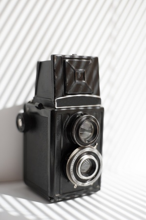 vintage black camera stands on a window sill Stock Photo - 21480667