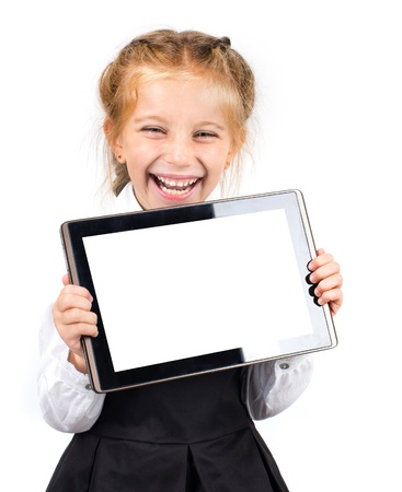 cute laughing schoolgirl with a pc tablet on light background