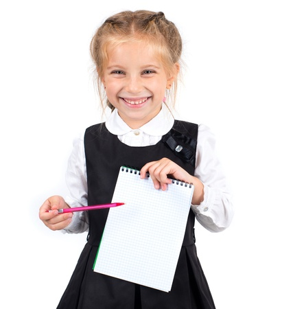 cute schoolgirl with a white sheet of notebook and pen