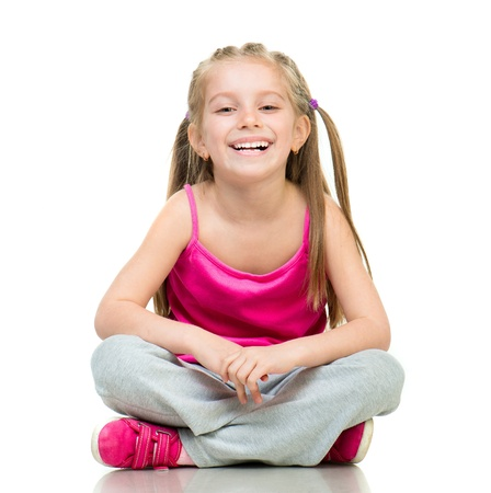 Smiling Little girl gymnast in studio over white background Stock Photo