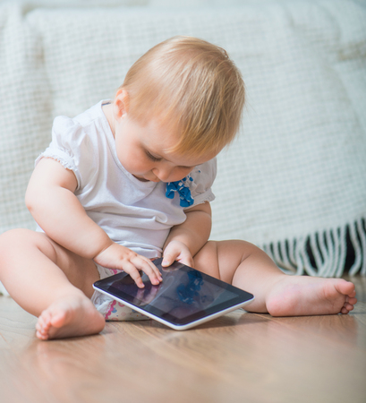 adorable baby with tablet PC