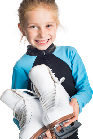 Little girl with skates isolated on white background photo