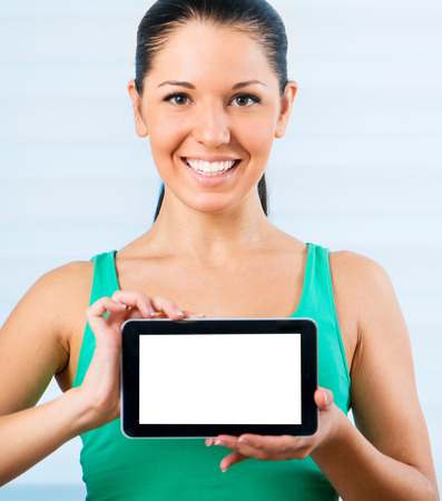 touch pad: young smiling brunette woman holding a touch pad Stock Photo