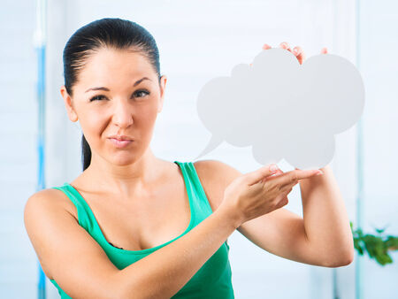 gloomy: Gloomy young brunette woman holding a white cloud for text
