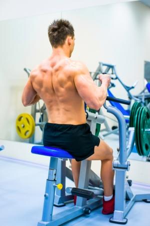 simulator: bodybuilder doing exercises on the simulator