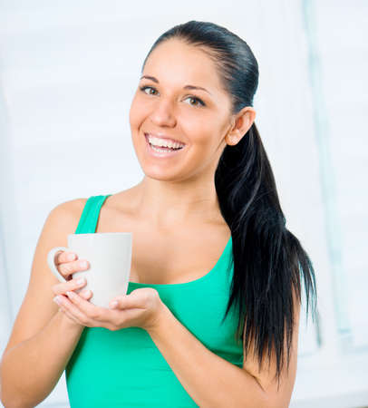 smiling girl with cup photo