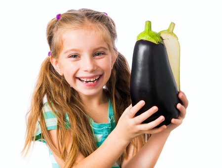 little girl with eggplant halves photo