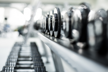 dumbells: Rows of dumbbells in the gym