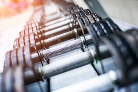 dumbbells in modern sports club  Weight Training Equipment Stock Photo - 24681070