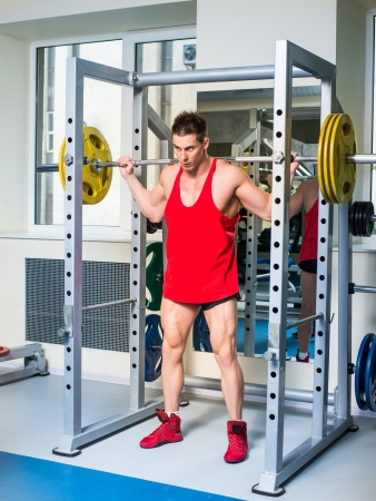 weightlifter: weightlifter squats with a barbell
