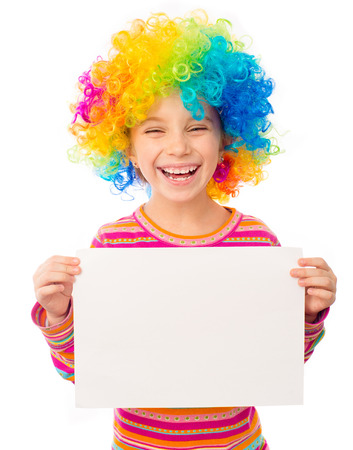 smiling little girl in clown wig with white blank isolated on white background