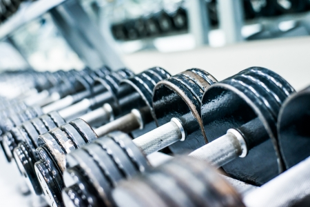 dumbbells: Sports dumbbells in modern sports club  Weight Training Equipment