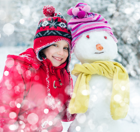 smiling little girl and snowman photo