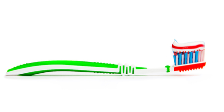 toothbrush with toothpaste isolated on a white  photo