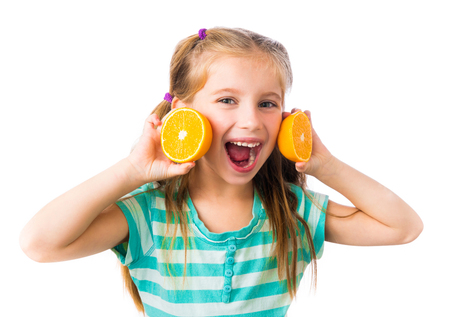 little smiling girl with two halves of oranges isolated on white background Stock Photo