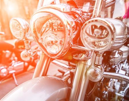 brilliant headlight motorcycle in sunlight photo