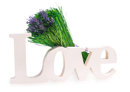Sign of love with a bunch of green grass with purple Lavender  Isolated on white photo