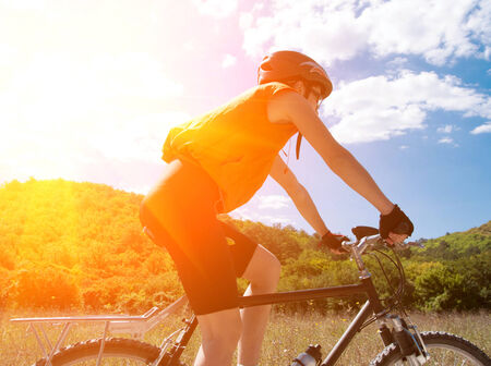 mountain biker: Person riding a mountiain bike on a slope Stock Photo