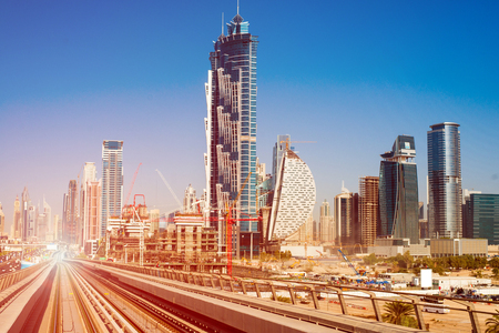 middle of the road: modern subway line on the urban landscape in Dubai Stock Photo