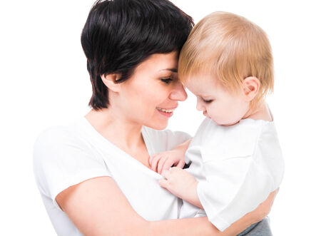 Brunette holding a baby in her arms  Isolated on white photo