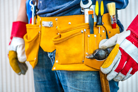 leathern: man and tools in leathern belt Stock Photo