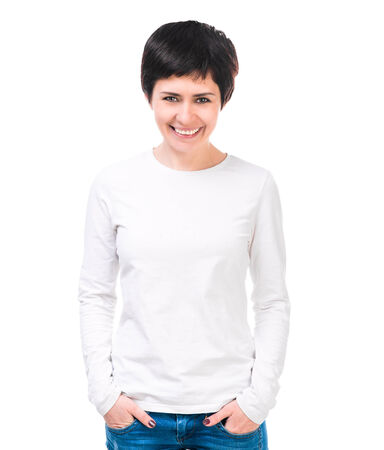 waist deep: Smiling brunette woman in white blouse and jeans  Isolated on white