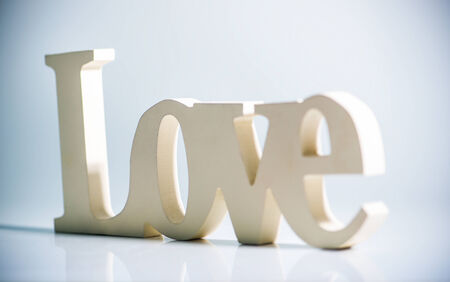 The word love with reflection Stock Photo