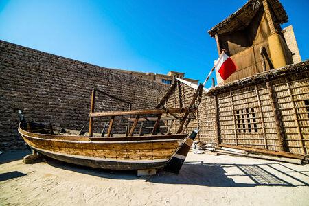 bur dubai: old boat on near fahidi fort, dubai, united arab emirates