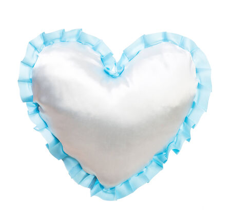 Blue silk pillow in the shape of heart isolated on white photo