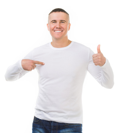 young man in a white shirt with long sleeves with thumbs up isolated on white background
