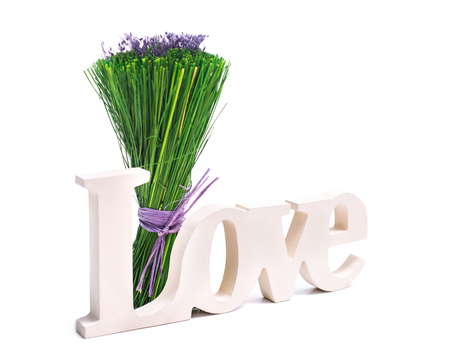 Sign of love with a bunch of green grass with purple flowers  Isolated on white photo