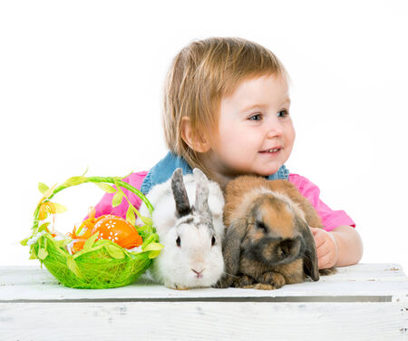 baby with Easter bunny and two basket with eggs photo