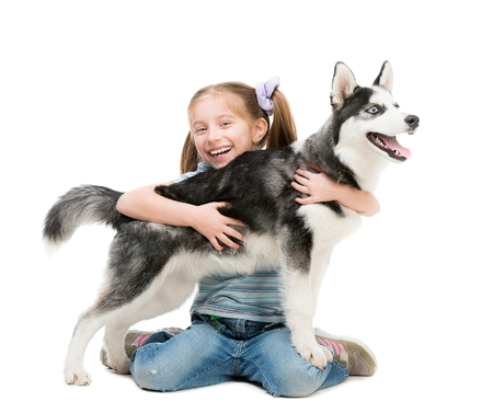 happy little girl and dog on a white photo