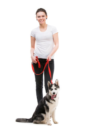 portrait of happy girl in white t-shirt and black trousers isolated photo
