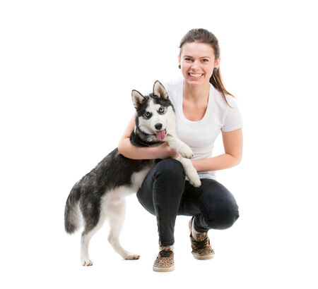 portrait of happy girl in white t-shirt isolated on white background and husky dog photo