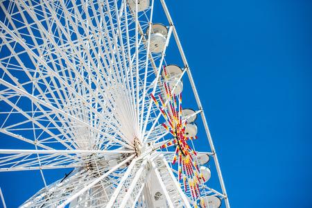 family fun day: ferris wheel against a blue sky