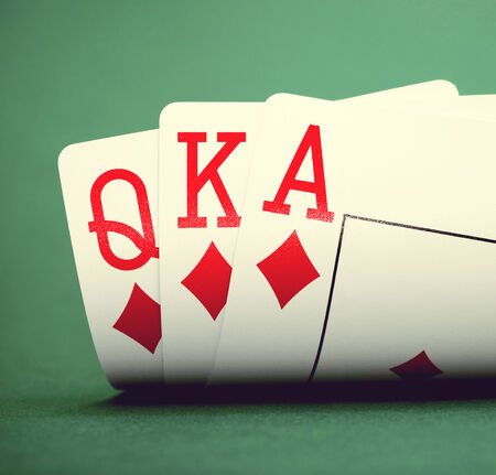 poker hand: playing cards on a green table casino