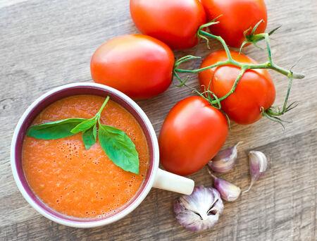 gaspacho: Bowl of tasty tomato soup gaspacho with basil, tomatoes and garlic