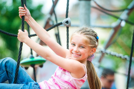 cute beautiful smiling little girl on a playground Stock fotó