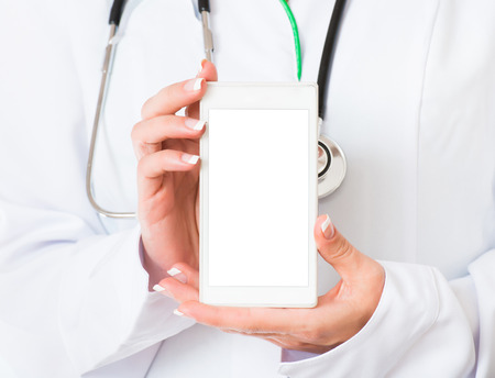 Female doctors hands with white mobile phone photo