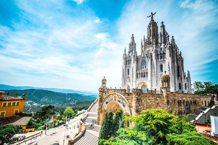 tibidabo: Tibidabo church on mountain in Barcelona with christ statue overviewing the city Stock Photo