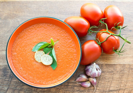 gaspacho: A bowl of tomato soup gaspacho with basil and crackers Stock Photo