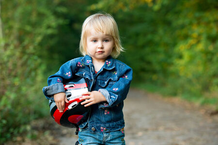 Beautiful little girl with sport helmet for bicycle, roller or skate photo