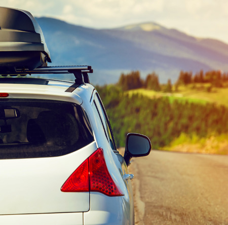 racks: car for traveling with a roof rack on a mountain road