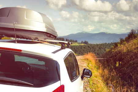 car for traveling with a roof rack on a mountain road photo