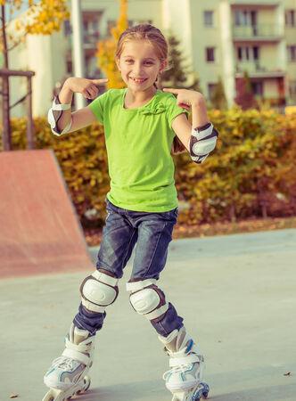 rollerskating: Little girl on roller skates  at a park