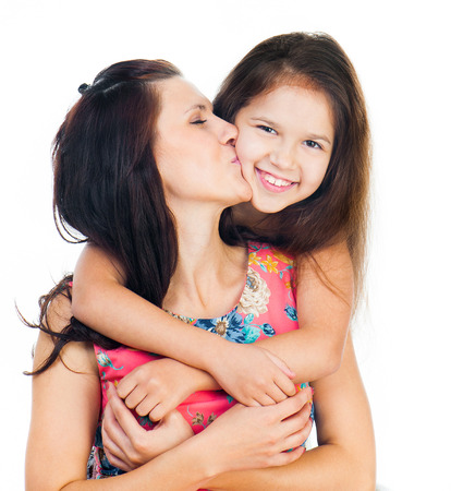 two women hugging: Cute little girl hugging her mother. Happy family.