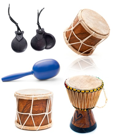 african drums: collage photos of African drums and percussion isolated on white background